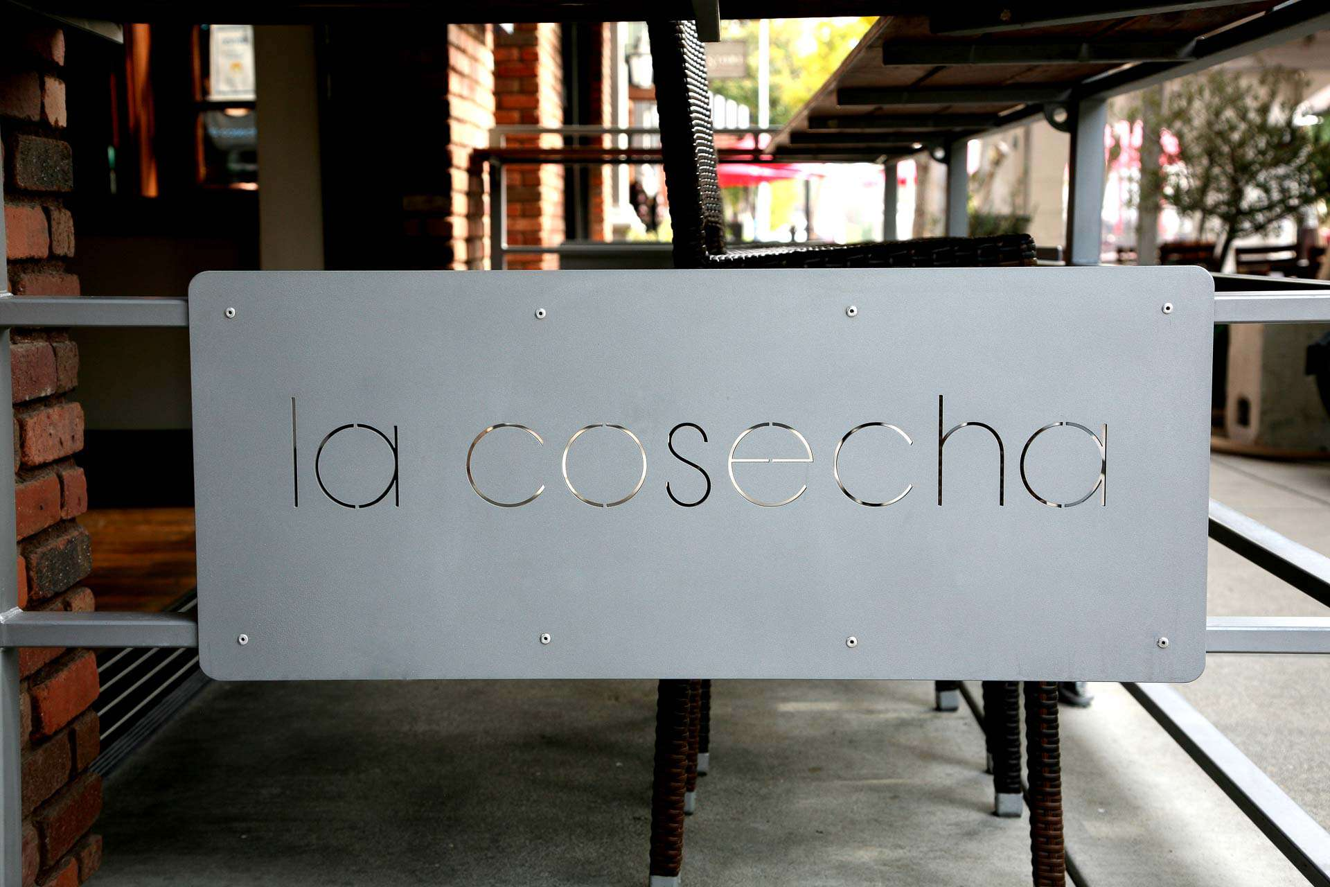 La Cosecha sign on front patio